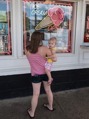 Katie Jones and 2-year-old daughter Chloe wait for their order at Dairy Dan.