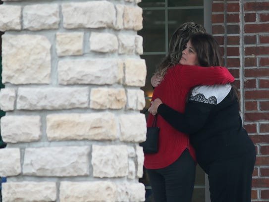 Mourners pay their respects at a visitation for the