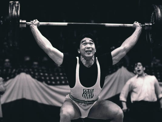FILE - In this May 17, 1958, file photo, Tommy Kono, of the United States, competes in a weightlifting match between the U.S. team and a visiting Russian team in New York. Kono, who took up weightlifting in an internment camp for the Japanese and went on to win two Olympic gold medals for the United States, has died. The U.S. Olympic Committee announced that Kono died Sunday, April 24, in Honolulu. His daughter, JoAnn Sumida, told The New York Times the cause was complications from liver disease. He was 85. (AP Photo/Marty Lederhandler, File)
