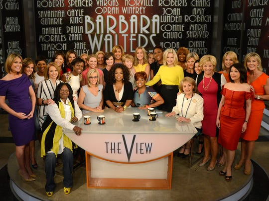 "This image released by ABC shows (seated from left) Whoopi Goldberg, Jenny McCarthy, Oprah Winfrey, Sherri Shepherd and Barbara Walters posing with female broadcasters during a taping of Walters' final co-host appearance on ""The View."""
