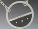 A concrete and silver necklace by Marjorie Bryan.