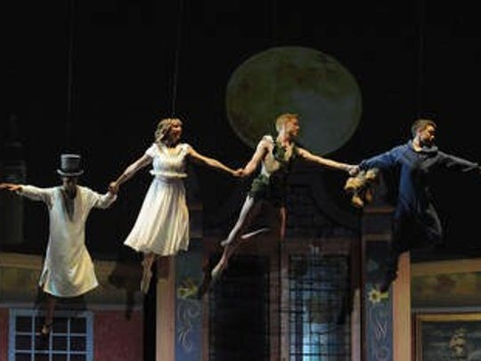 Peter Pan and the flying Darling children.