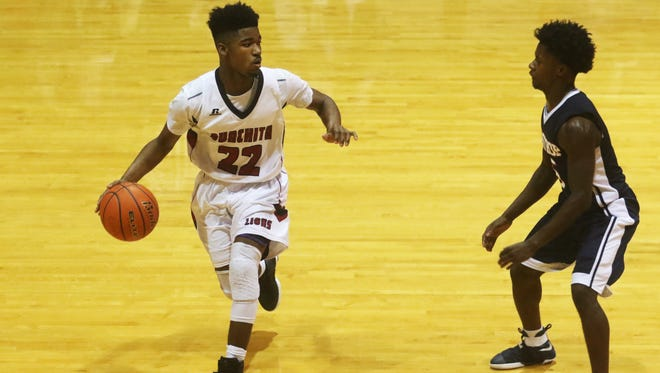 Ouachita guard Donald Williams Jr. keeps an eye on Bastrop point guard Christian Smith as he dribbles the ball during a game on the first day of the Don Redden Memorial Classic at Ouachita High School on Wednesday, January 4, 2016.