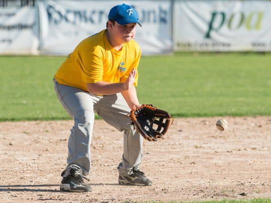 A Fruitland third baseman fields a ground ball during