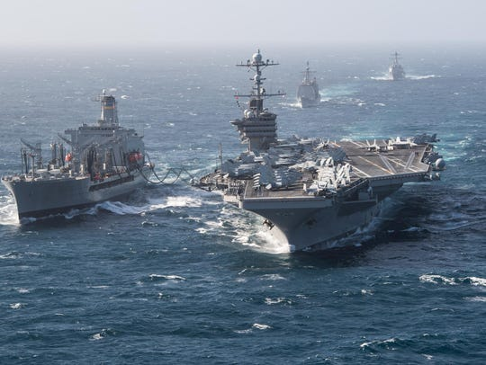 The aircraft carrier USS John C. Stennis conducts a replenishment-at-sea with the fleet replenishment oiler USNS Henry J. Kaiser.
