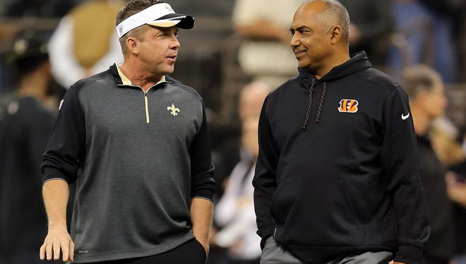 Saints head coach Sean Payton (left) talks to Bengals head coach Marvin Lewis before Sunday's game.
