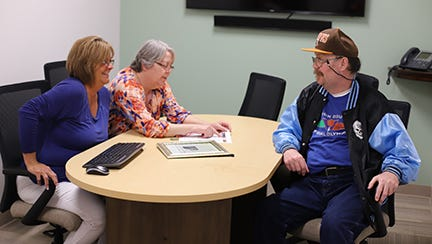 Dan Cassell, right, with his sisters Cheryl Pfeiffer, left, and Diana Trefzger reminisce about Dan riding a bike to work in the blizzard of 1978.