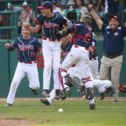 Maine-Endwell celebrates its victory Saturday in the