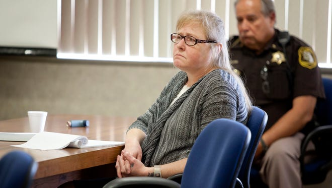 Judy Higley-Zuehlke listens during opening statements Tuesday in the courtroom of Judge Michael West at the St. Clair County Courthouse. Higley-Zuehlke is charged with second-degree murder in connection with the February death of John Allen.