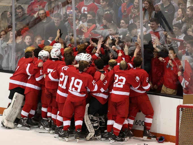 Canandaigua celebrates with fans after winning the