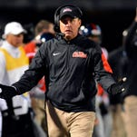 Nov 21, 2015; Oxford, MS, USA; Mississippi Rebels head coach Hugh Freeze reacts after a play during the third quarter of the game against the LSU Tigers at Vaught-Hemingway Stadium. Mississippi won 38-17.  Mandatory Credit: Matt Bush-USA TODAY Sports