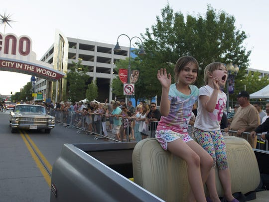 Kids ride in the cruise at Hot August Nights 2014 in downtown Reno.