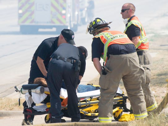 Paramedics attend to a firefighter that was taken away