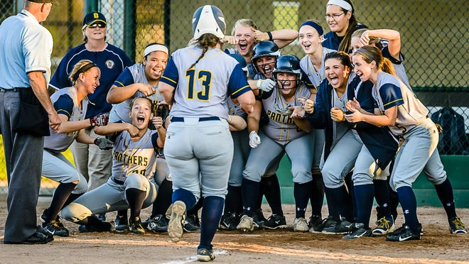 The DeWitt softball team celebrates as they wait for teammate Abby VanLake ,13, to touch homeplate after hitting a 3 run homer to tie their Softball Classic semifinal game with Grand Ledge at 8 all Wednesday May 18, 2016 at Ranney Park in Lansing. KEVIN W. FOWLER PHOTO