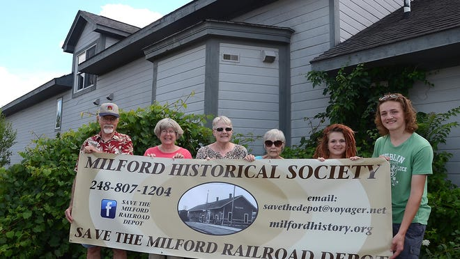 A group of Milford residents is hoping to save the the 1871 railroad depot, located on the former Iverson's Lumber property on East Huron, and have it moved across the street to property the village plans to use as a parking lot. Some of those involved in the effort are, from left: Ralph Emmons, Arlene Griswold, Carol Conner, Linda Dagenhardt, Chloe Miller and Jon Shafto.