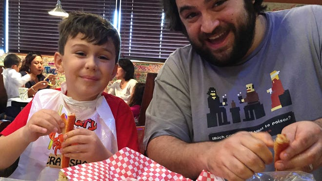 Matteo Armato and his father, dining critic Dominic Armato, eat snow crab at Angry Crab Shack.