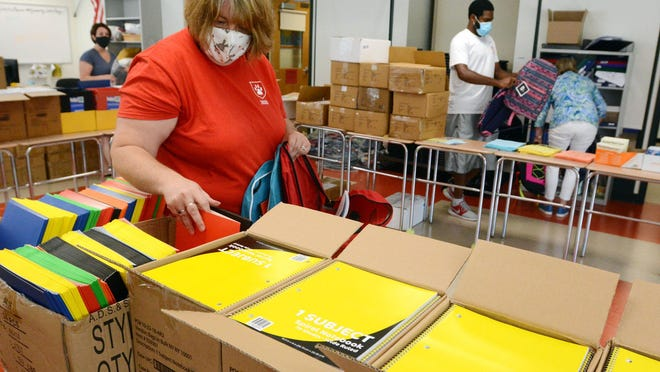 Jodi Savage, project outreach coordinator at Norwich Free Academy, fills backpacks with back-to-school supplies Monday during the Norwich Community Backpack Program at the Sachem Campus of NFA. More the 850 backpacks were filled for children in need. See video at NorwichBulletin.com