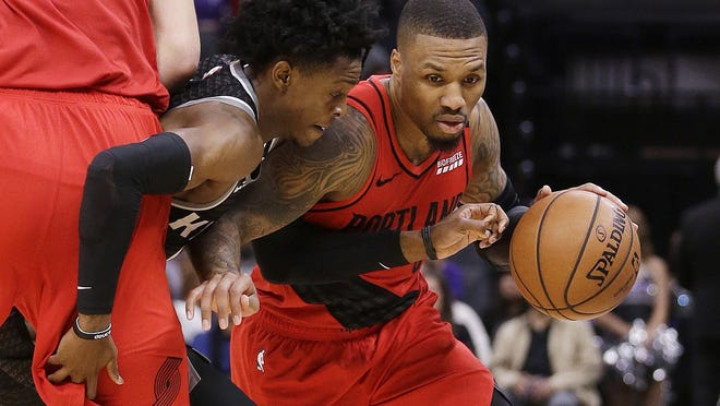 Portland guard Damian Lillard works his way to the basket during the second half against Sacramento on Tuesday.
