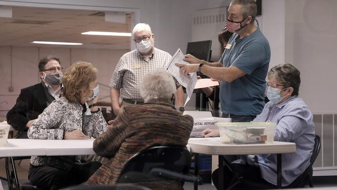 Deputy Director of the Richmond County Board of Elections Travis Doss gives instructions to poll workers as they prepare to count provisional and military ballots at the Board of Elections  warehouse on November 7, 2020 in Augusta, Ga.