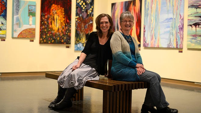 Shanti Bennett, left, and Linda Rauscher of the Green Bay Art Colony sit near the club's display at the Neville Public Museum of Brown County in downtown Green Bay. The club is celebrating it's 100th anniversary.