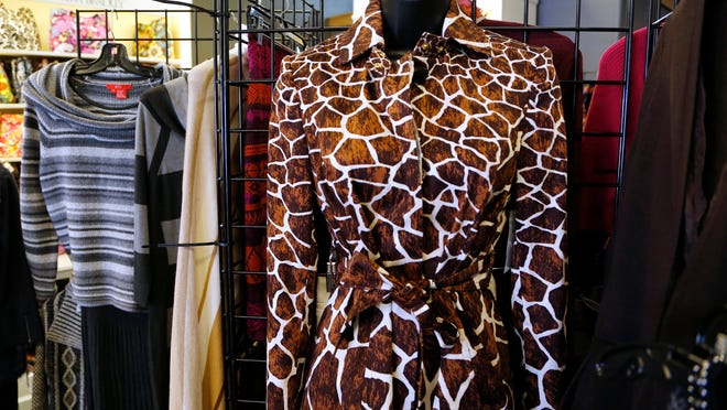 A dress featuring a giraffe print Tuesday at Merle Norman Cosmetics in Lafayette. Animal prints are popular with fall fashions this year.