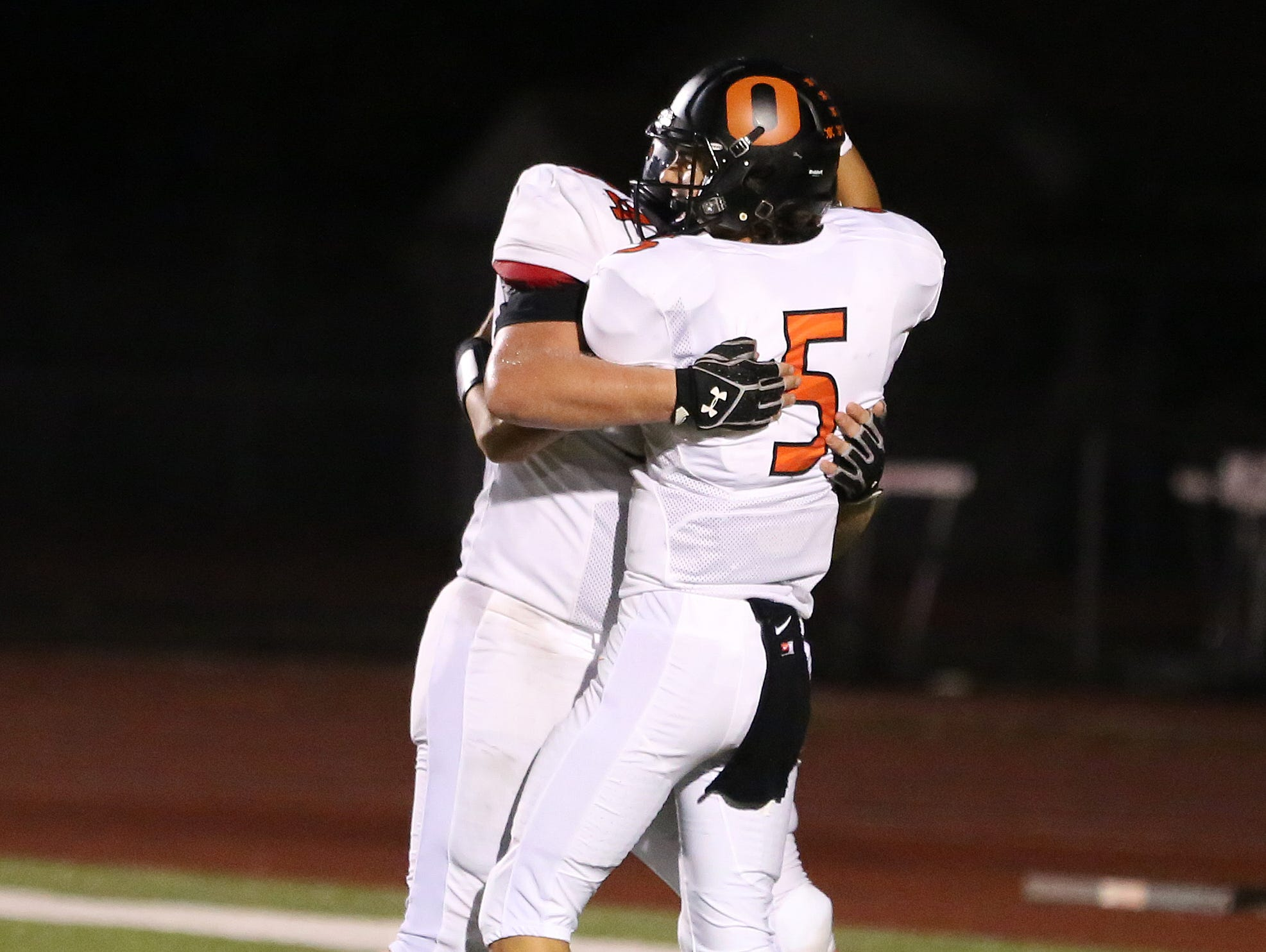 Sprague's Spencer Plant (No. 5) celebrates a touchdown against the McMinnville Grizzlies in Greater Valley Conference game on Friday, Sept. 23, 2016, in McMinnville.