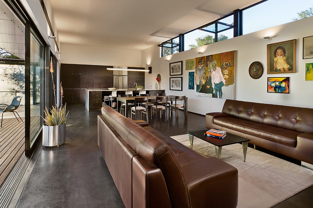 Vallone design elegant office Furniture The New Building Features Glass Facade Facing The Architonic Architect Couple Transform Tempe Bungalow Into Unconventional Paradise