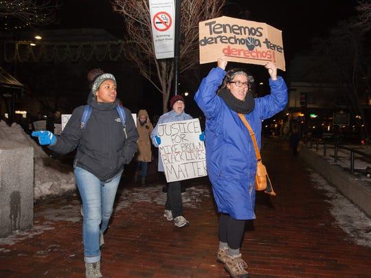 """Demonstrators marching at the beginning of a long line are among the first to arrive at a """"Black Lives Matter"""" rally on lower Church Street in Burlington Monday night."""