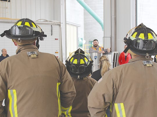 Firefighters watch as Landmark Services Cooperative