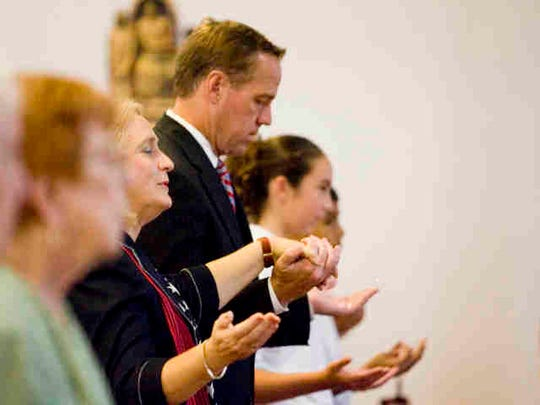 St. Theresa Catholic School Principal Cheryl Corey and Palm Springs Mayor Steve Pougnet hold hands during remembrance of Barbara Keating and to commemorate the 10-year anniversary of the terrorist attacks on the World Trade Center in New York City.