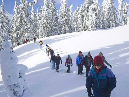 The Visitor Center at Crater Lake is covered in snow,