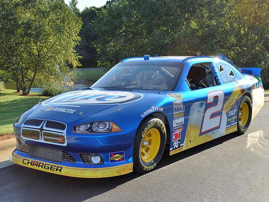 Nascar racer Brad Keselowski, the 2012 Sprint Cup champion, is auctioning off his stock car to benefit Paralyzed Veterans of America at Barrett-Jackson on Jan. 28, 2016.