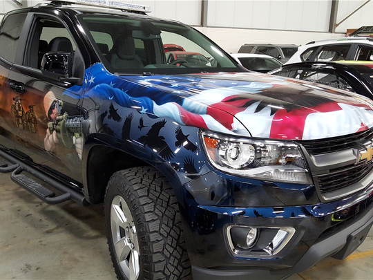 This Chevy Colorado features a unique exterior honoring the U.S. military and is up for auction at Barrett-Jackson in Scottsdale on Jan. 28, 2016.