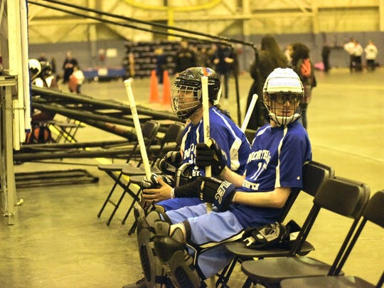 From right, Daniel Engel and Paulo Teixeira, Special Olympics athletes, wait for their turn at florr hockey on Saturday