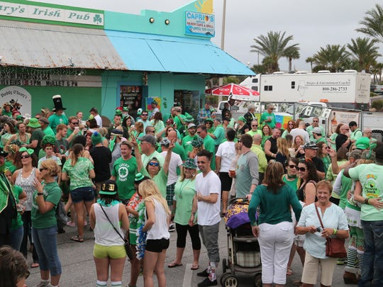 The parking lot at Paddy O'Leary's Irish Pub on Pensacola Beach is filled with revelers as the 2016 Pensacola Beach Chamber of Commerce St. Patrick's Day Pub Crawl stopped in Thursday afternoon. Paddy O'Leary's featured entertainment inside and out, including appearances by St. Patrick himself, live music and a re-enactment of Tim Finnegan's Wake.