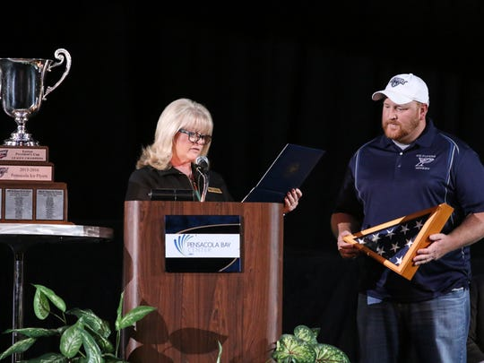 Ice Flyers owner Greg Harris, shown with Bay Center general manager Cyndee Pennington during championship celebration in May, has narrowed search for new head coach and should name one within 10 days.