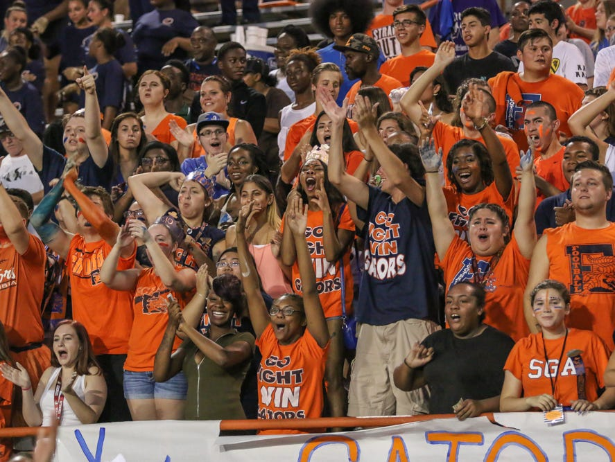 Escambia High School students cheer on their team Thursday night at Escambia High School's Emmitt Smith Field.