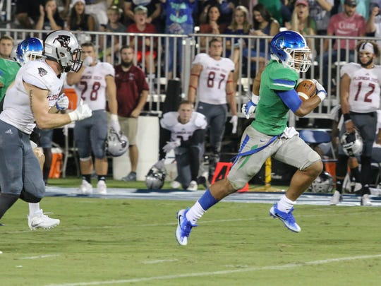 West Florida's Ishmel Morrow (11) beats the Florida Tech defense and makes his way to the endzone for a touchdown Saturday night during the Argos' second home game of the year.