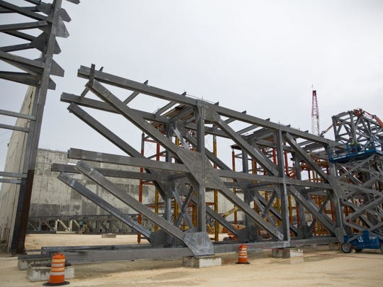 Seven box trusses, each weighing 100 tons, were recently installed as part of the construction of a Marine Corps hangar for Osprey aircraft on Northwest Field at Andersen Air Force Base.