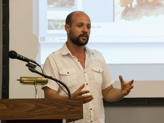 Peruvian artist Diego Alonso Carbajal speaks during his special presentation at Pensacola State College earlier this week.  Carbajal is the 2016 Invited International Artist for The Great Gulfcoast Arts Festival.