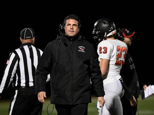 Northern Highlands head coach Keith Migliorino looks disappointed after another Gaels touchdown.