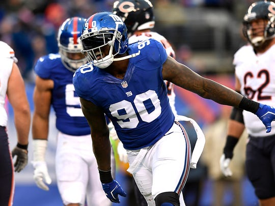 Giants defensive end Jason Pierre-Paul (90) celebrating after another sack of Chicago Bears quarterback Jay Cutler (not pictured).