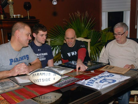 Three generations of the LaBarbiera family are involved in Paramus football.  Shown left to right in 2014, are Rich LaBarbiera, Richard LaBarbiera,  Pete LaBarbiera, Pete LaBarbiera Sr. looking at family memorabilia.