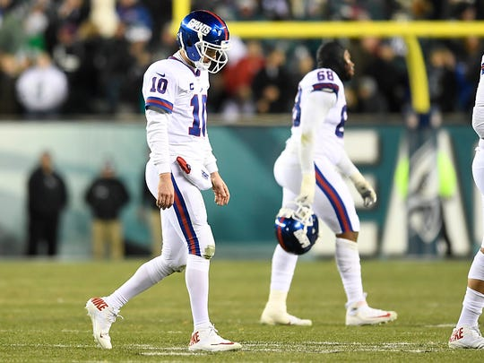 New York Giants quarterback Eli Manning (10) walks off the field after a late fourth quarter interception ends the Giants run at Lincoln Financial Field in Philadelphia, PA on Thursday, December 22, 2016.