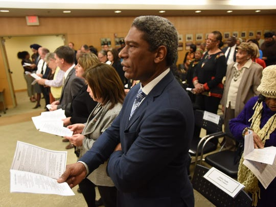 Bergen County Counsel Julien Neals singing at a Black