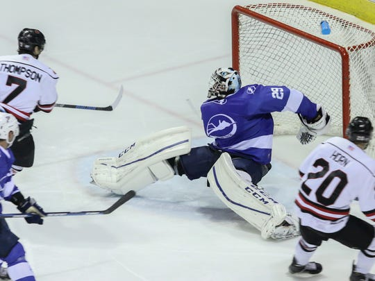Pensacola goalie John McLean stretches out to deflect