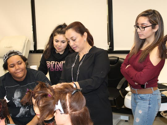 Cosmetology students Kiara Brown of Green Brook, Heather