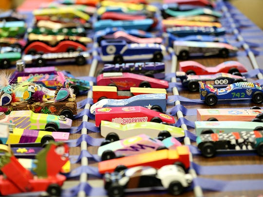 Pinewood Derby cars built by Girl Scouts.