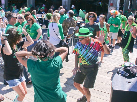 """Hundreds of people got into the St. Patrick's Day spirit at Crabs We Got 'Em, Holiday Inn Resort, Paddy O'Leary's Irish Pub, Paradise Bar & Grill and Flounders Chowder House during the Pensacola Beach Chamber of Commerce's 2017 """"Go Irish on the Island"""" St. Paddy's Day pub crawl  Friday afternoon."""