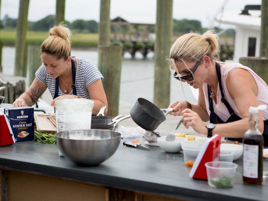 """TOP CHEF -- """"Shrimp Boats and Hat Ladies"""" Episode 1410 -- Pictured: (l-r) Brooke Williamson, Casey Thompson -- (Photo by: Paul Cheney/Bravo)"""